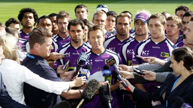 'We ain't going to surrender' ... Storm coach Craig Bellamy, backed by all his players, faces the media yesterday but ...