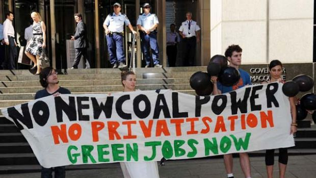 Climate change activists display black balloons (representing pollution) outside the offices of the NSW government in ...