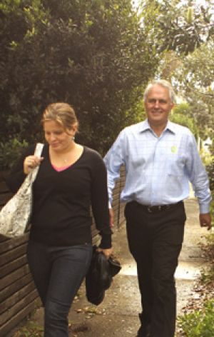 Striding back... a confident Malcolm Turnbull with daughter Daisy yesterday.