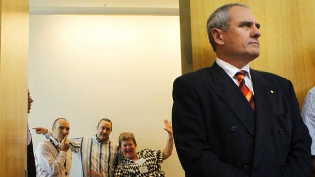 Treasury secretary Ken Henry and staff  wait for the Treasurer to arrive at Parliament House.