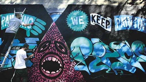 """Urban artists ... """"Numskull"""" (left) and """"Beastman"""" paint a legal mural in Surry Hills as a protest against Graffiti ..."""