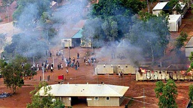 Bad memories of isolation and uncertainty  ...  detainees gather after a building at Curtin is set alight in March 2001.