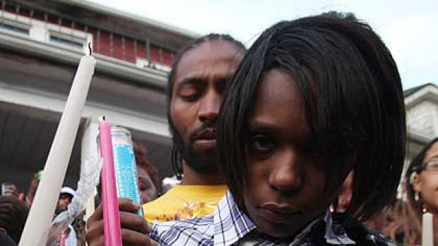Dominika Stanley and Charles Jones, mother and father of Aiyana Jones gather for a candle light vigil for their ...
