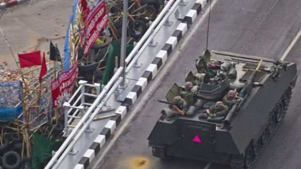 Thai troops aboard an armoured personnel carrier take aim at anti-government protesters in Lumpini Park in downtown Bangkok.