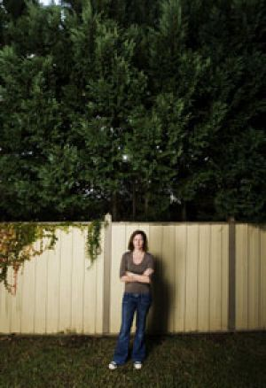 Tired of having her views blocked ... Julie Giannesini, of Mosman, and the 12-metre hedge along her northern boundary.