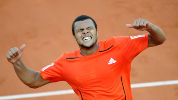 France's Jo-Wilfried Tsonga reacts as he defeats Germany's Daniel Brands in the first round of the French Open.