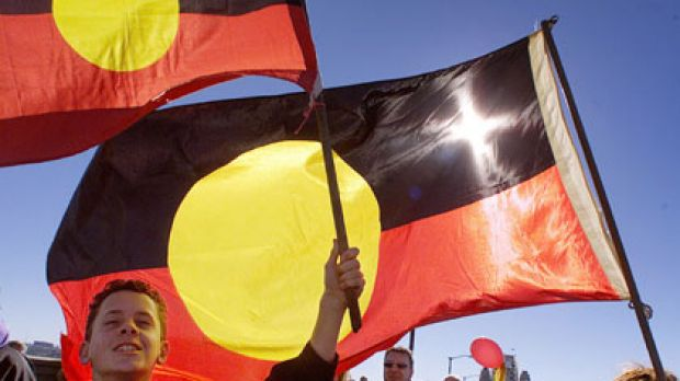 Unity ... a boy and his mother carry the Aboriginal flag as they cross the Sydney Harbour Bridge.