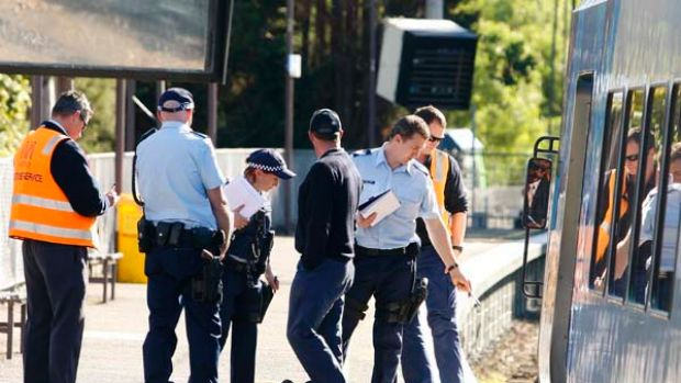 Police, paramedics and Metro Trains investigators at Tooronga Station in Melbourne where a one-year-old boy in a pram ...