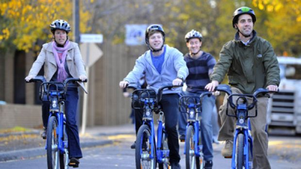 Riders take part in the first day of the Melbourne Bike Share scheme at Melbourne University.