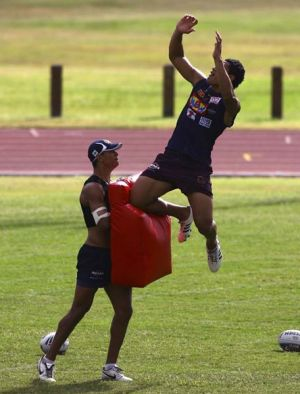 Up there, Izzy ... Minto-born Israel Folau practises going for the high ball.
