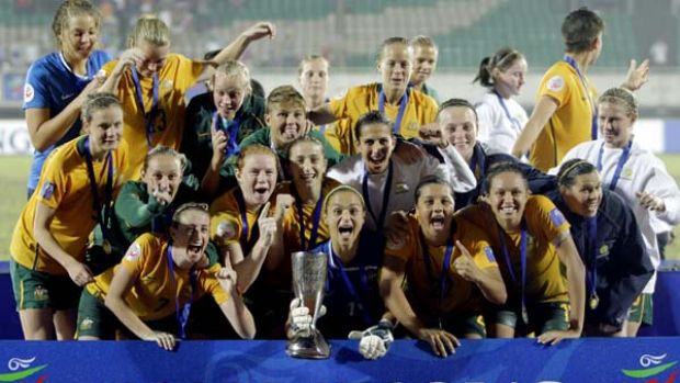 The jubilant  Matildas - Australia's women's soccer team - at the presentation to receive the Asian Cup they won in a ...
