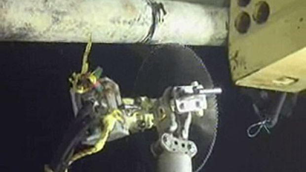 From BP's video feed yesterday ... the robotic saw goes to work on the oil pipe  more than a kilometre deep.