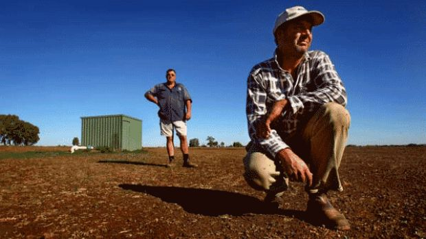 Farmers David (front) and Murray Glass installed a $80,000 on their property at the urging of the state government in ...