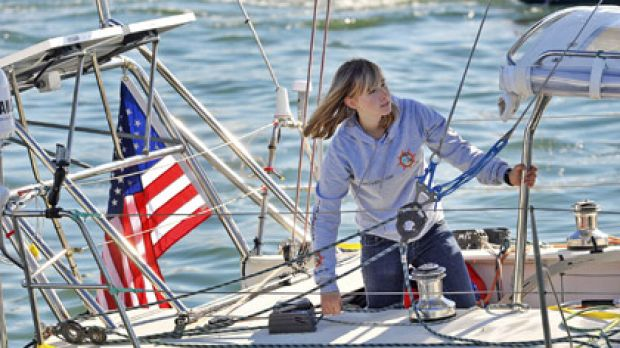 Abby Sunderland, 16, looks out from her sailboat, Wild Eyes, as she leaves for her world record attempting journey at ...