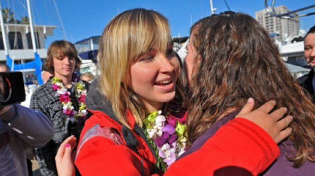 Abby Sunderland, left, 16, gets a hug from friend Casey Nash, right, before leaving for her world record attempting solo ...
