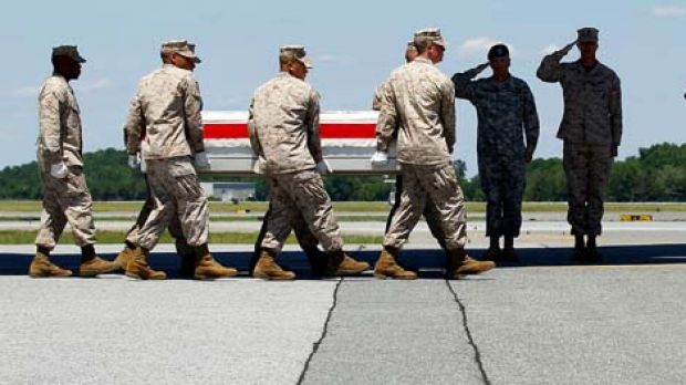 Sombre moment ... the remains of Lance Corporal Derek Hernandez, killed on June 6, return home.