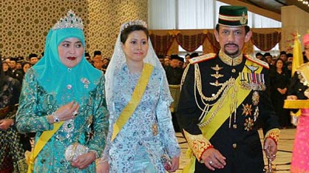 Brunei's Sultan Hassanal Bolkiah  with first wife Queen Saleha  and second wife Azrinaz Mazhar Hakim, right.