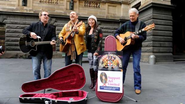 Swanee, Colin Hay, Cecilia Noel and Keith Potger busking in the city.