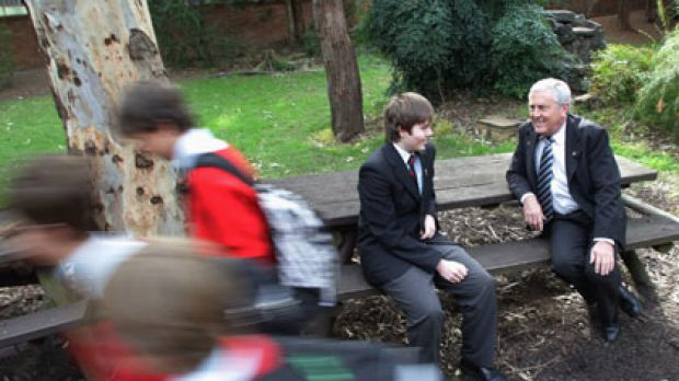 Reaping the benefits ... the principal of Edmund Rice College, David Lear, with year 11 student Sean McCarthy. The ...
