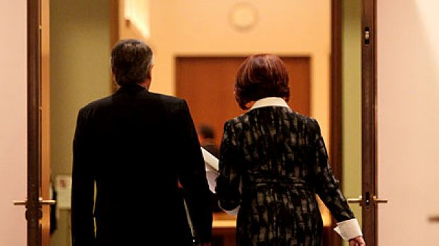 Julia Gillard and her deputy, Wayne Swan, enter yesterday's cabinet meeting.