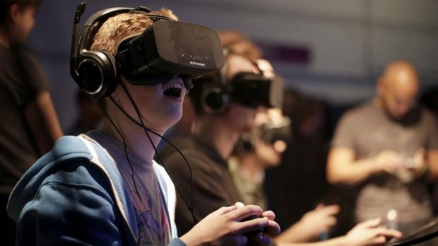 Gamers test the Oculus Rift headset at the Eurogamer Expo in 2013.