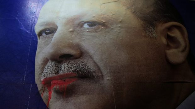 Overreaching: A huge poster of Turkish Prime Minister Recep Tayyip Erdogan seen in the city centre in Istanbul. His ...