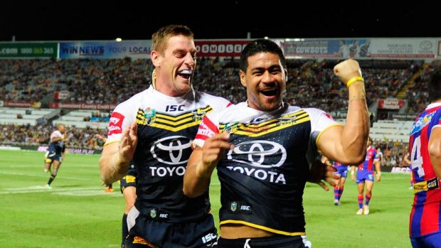 Matthew Wright celebrates his try with Brent Tate in North Queensland's thumping win over Newcastle in Townsville on ...