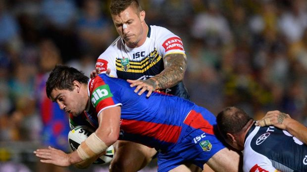 Tariq Sims gets to grips with Kade Snowden on Monday night.