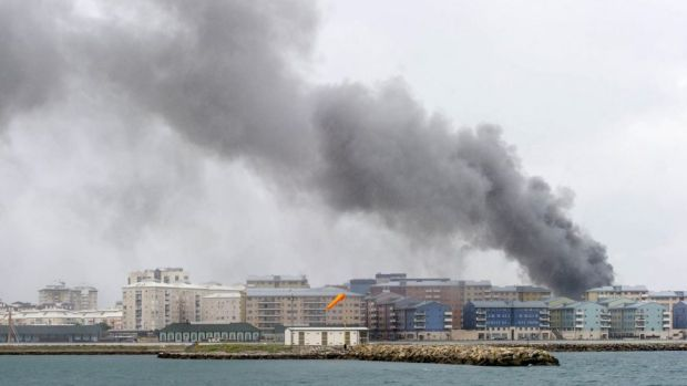 Smoke billows behind residential buildings following an explosion in Gibraltar.