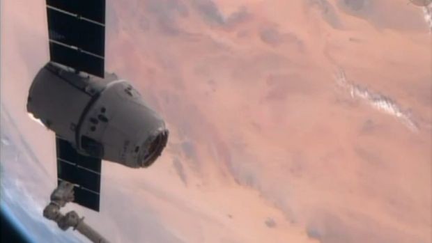 The SpaceX Dragon resupply capsule just prior to being captured by the Canadarm2 from the International Space Station.