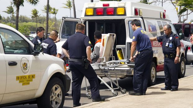 The 16-year-old who stowed away on a California to Hawaii flight, seen here on a stretcher, is loaded into an ambulance ...