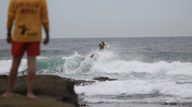The search continues for one of the men who jumped into the ocean in a rescue attempt.