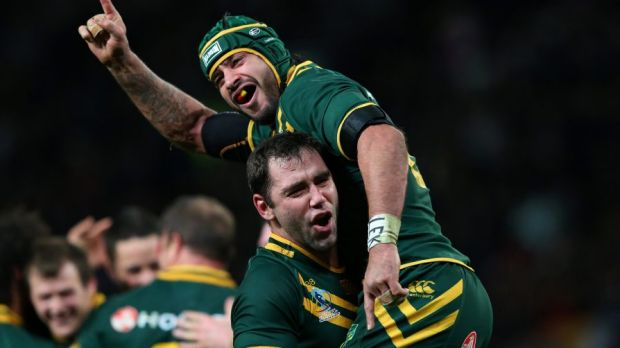 Icons: Cameron Smith and Johnathan Thurston after victory over New Zealand.