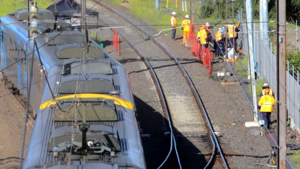 Workers inspect fire-damaged cables near Richmond station.