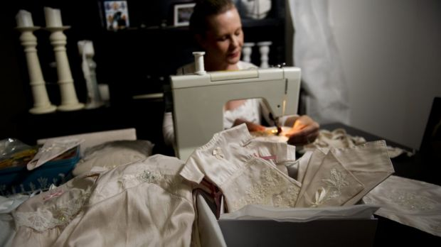 Angel Gowns founder Fiona Kirk at home, surrounded by the gowns she makes for stillborn babies or babies who die soon ...
