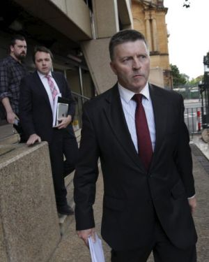 Out: Mike Gallacher leaves NSW Parliament House on Friday.