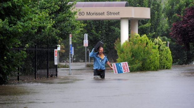 Dr David Poland leaves his flood affected surgery in in Morisset Street, Queanbeyan, during the 2010 flood
