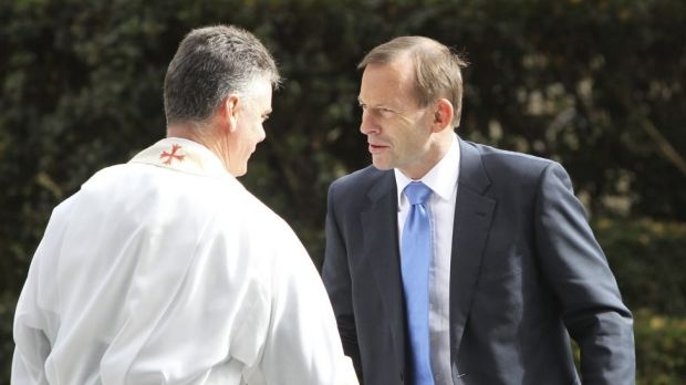 Prime Minister Tony Abbott arrives at Paul Ramsay's funeral