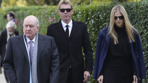 Alan Jones, Brett Lee and Lana Anderson arrive at Paul Ramsay's funeral.