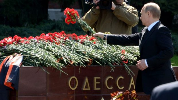 Rival claims: Russian President Vladimir Putin lays flowers at a Moscow memorial to Odessa's role in World War II.