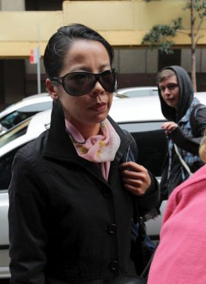 Kathy Lin, the wife of alleged killer Robert Xie, arrives at Sydney's Supreme Court.