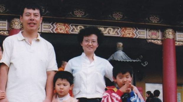 """Min """"Norman"""" Lin, 45,  with his wife Yun Li """"Lily"""" Lin, 43,and their two sons Lins' Henry and Terry"""