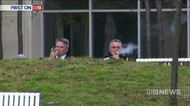 Treasurer Joe Hockey and Finance Minister Mathias Cormann enjoy cigars as the medical community petitions for ...