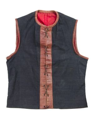 Demons jumper, 1900. Melbourne jumpers were made of sturdy blue linen, with a red leather strip hen down the front with ...