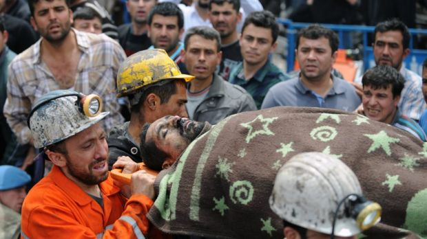 Rescue workers carry the body of a miner outside the coal mine in Soma, Turkey.