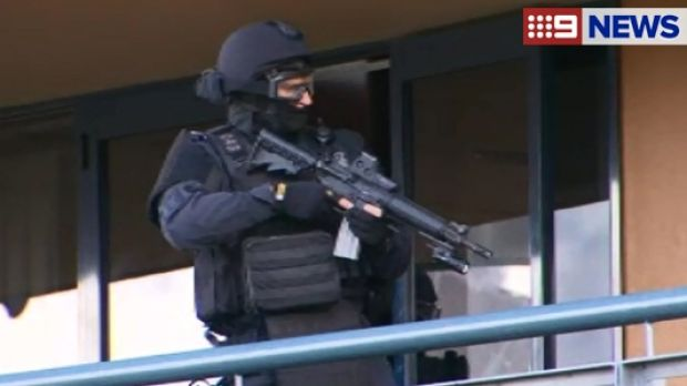 A Special Emergency Response Team officer performs a demonstration at Oxley.