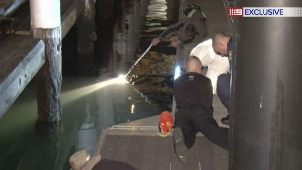 Police search for a missing man at Darling Harbour.
