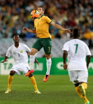Mathew Leckie takes control of the ball in a friendly between the Socceroos and South Africa earlier this week.