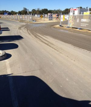 Trucks entering and exiting the Riverside project on the Swan River - to transform the eastern gateway into the city - ...