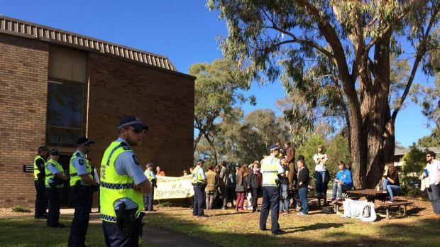 Armed police officers greeted protesters at Australian National University's (ANU) Acton campus.